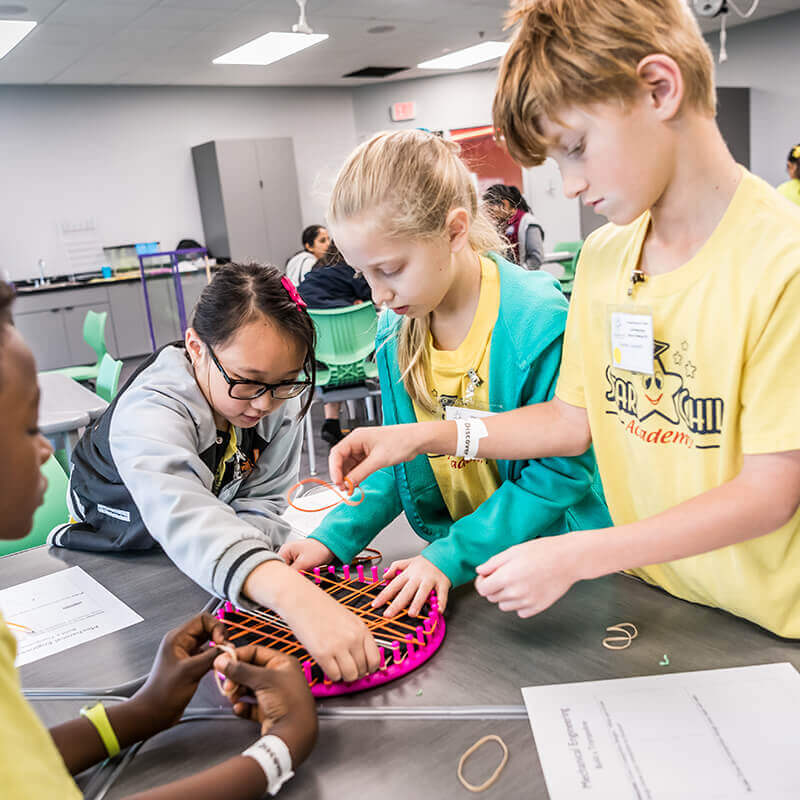 Students working together on a rubber band design during the Curtis Rising Stars Science Challenge.