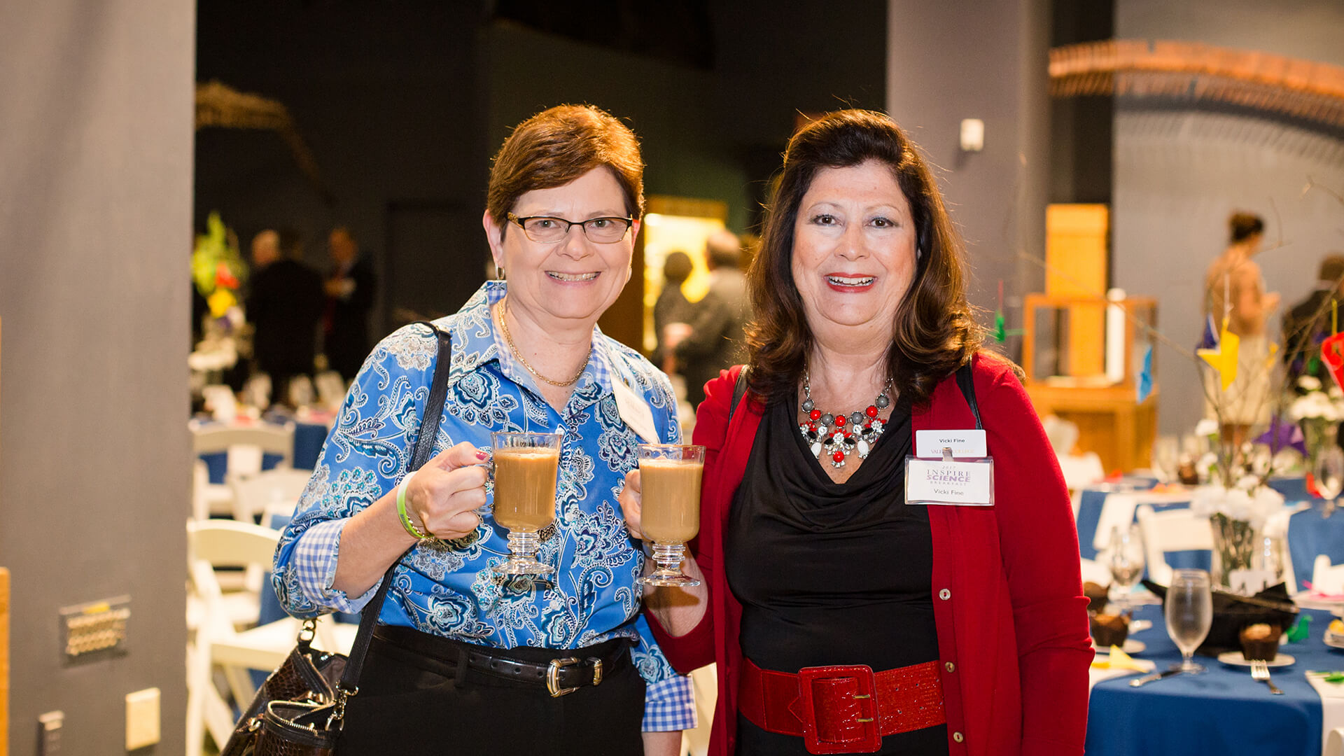 Women drink coffee together at the Inspire Science Breakfast.