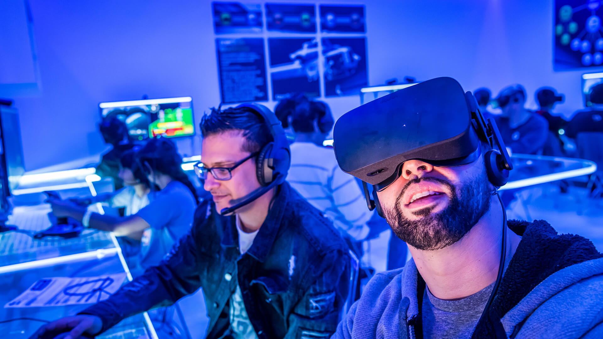 Visitors use virtual reality technology in the Flight Lab experience.