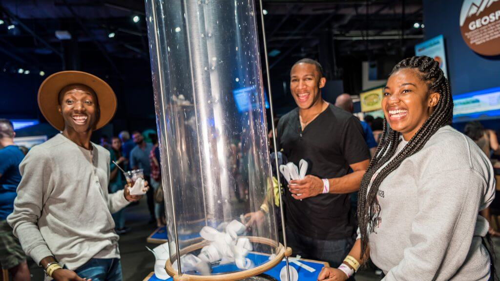 Science Night Live guests testing their creations in the wind tubes.