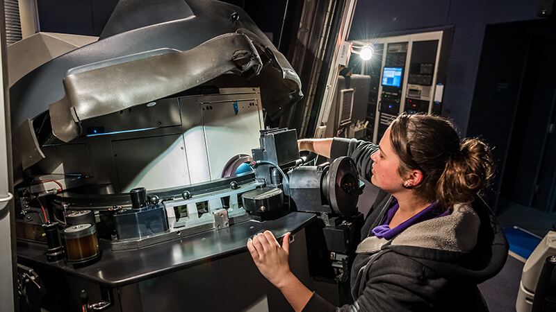 A theater employee operating the projection equipment.