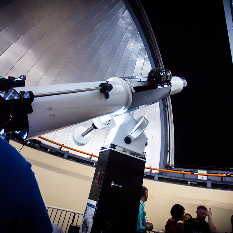 The refractor telescope pointed up at the sky.