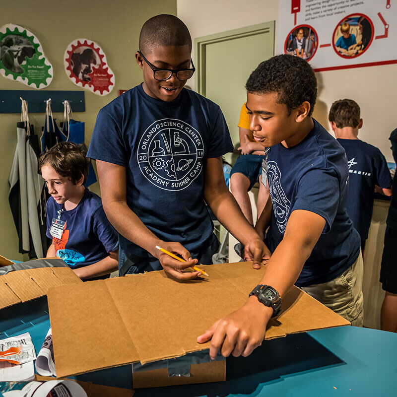 Two teens using cardboard for an experiment