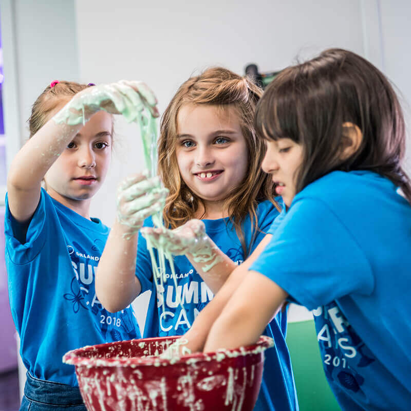 Kids play with slime during summer camp