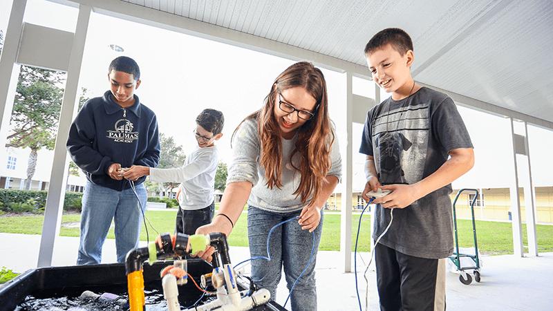 Fifth graders in afterschool program using robotics at their school.