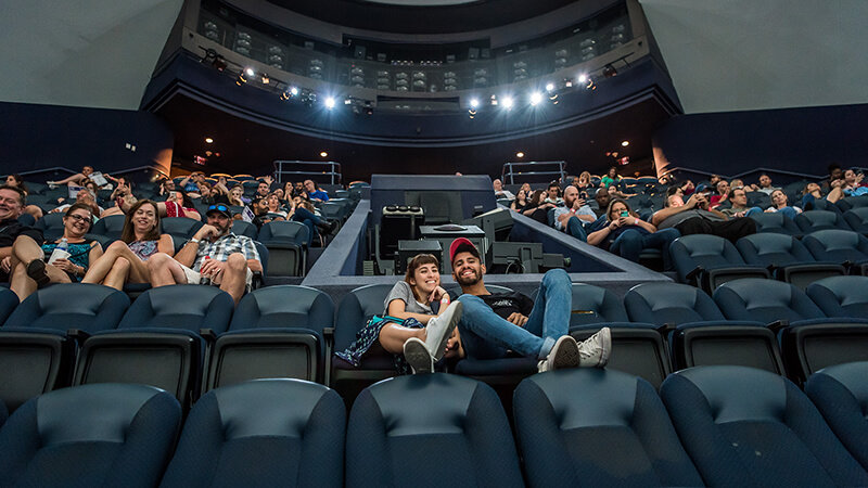 Guests waiting for a giant-screen film to start in the CineDome.