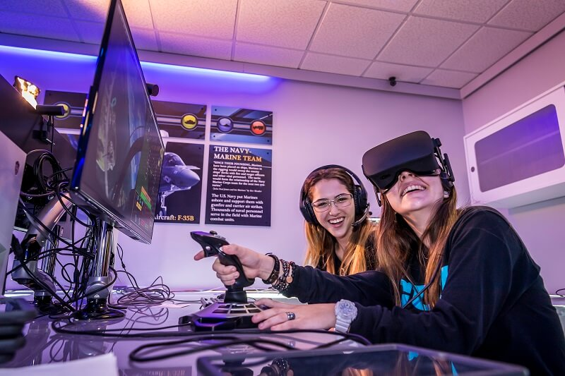 Two girls playing an virtual reality game