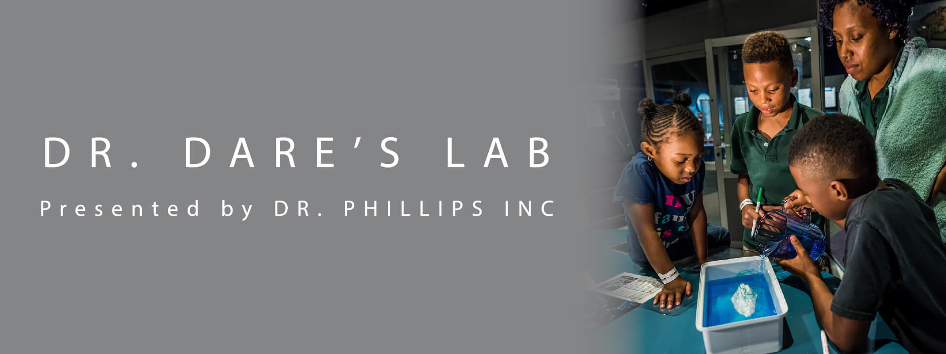 Dr. Dare's Lab logo with photo of family of four performing an experiment together in the lab.