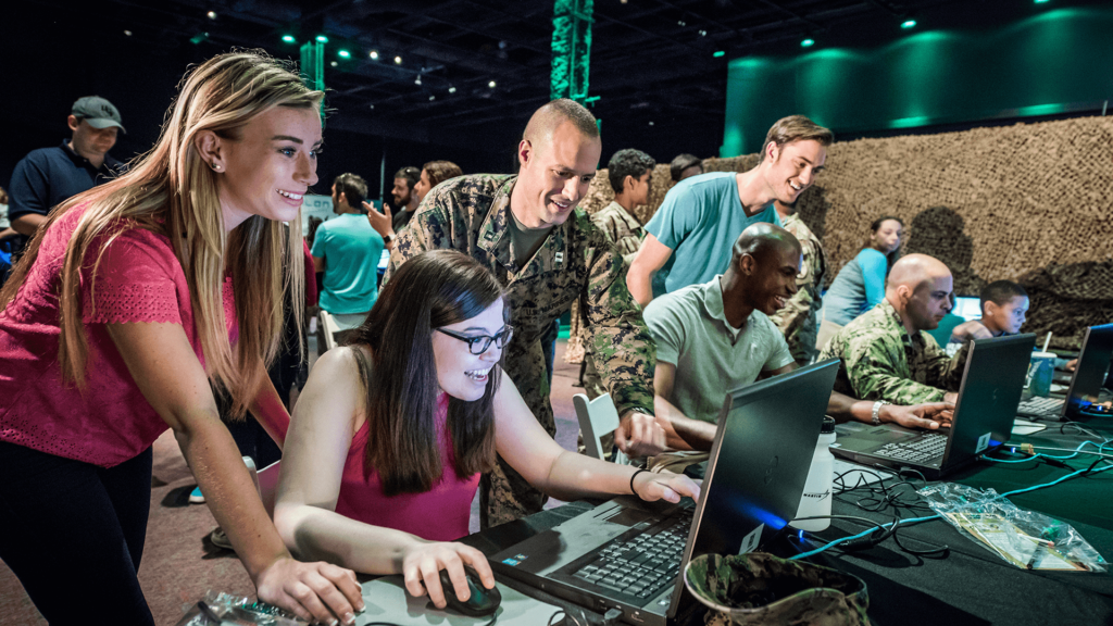 Guests test military simulators at the Otronicon technology event.