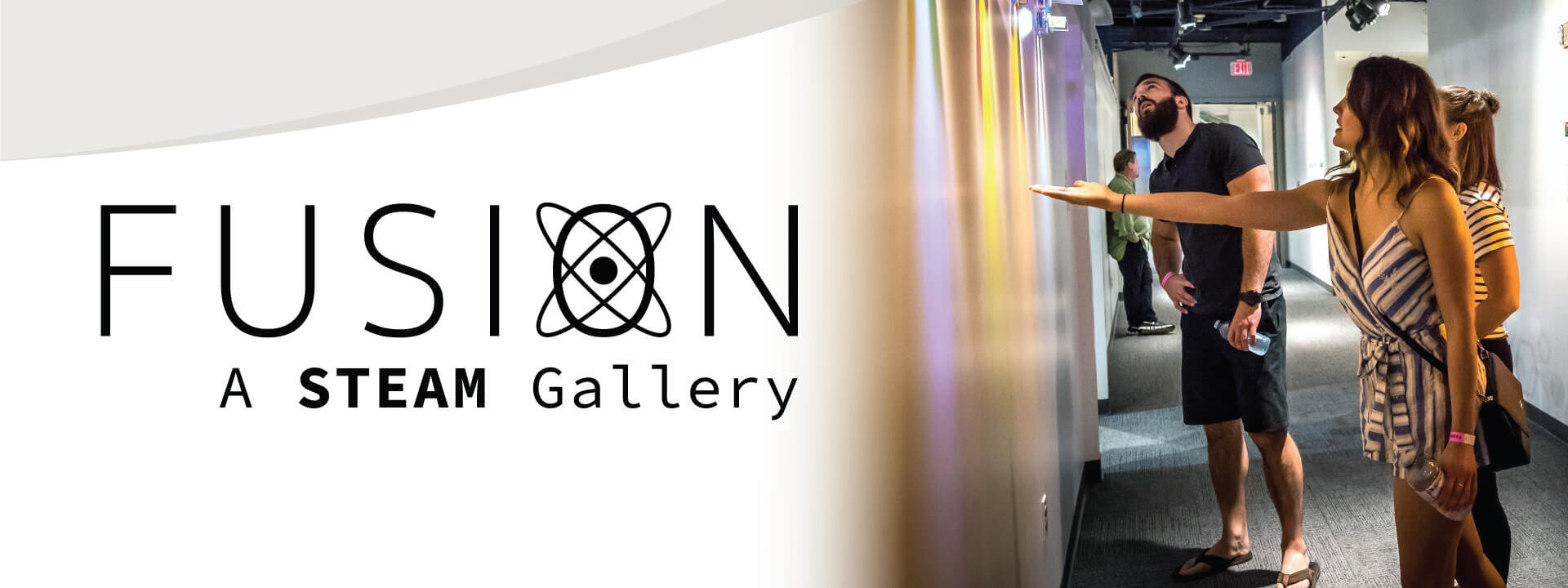 Fusion Gallery logo and photo of three young adults interacting with light beams from artwork piece.