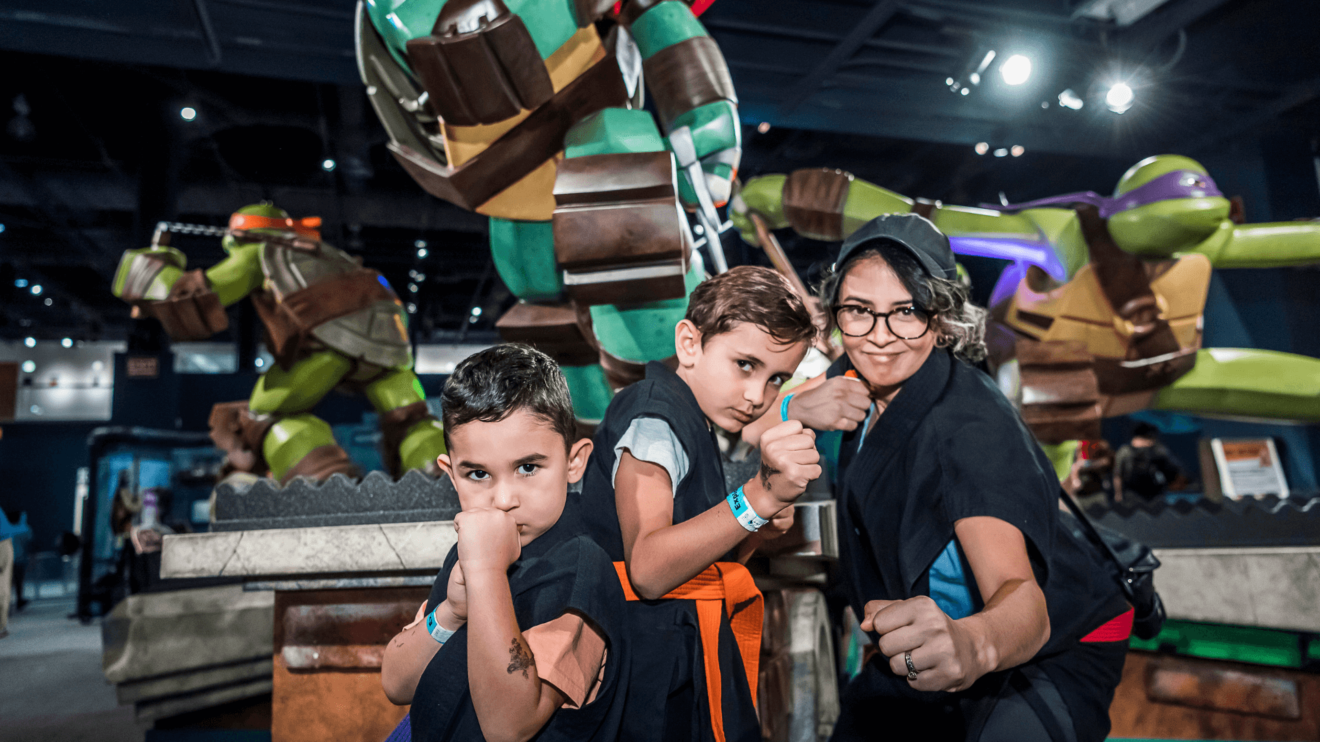 Image of guests posing in front of Teenage Mutant Ninja Turtles