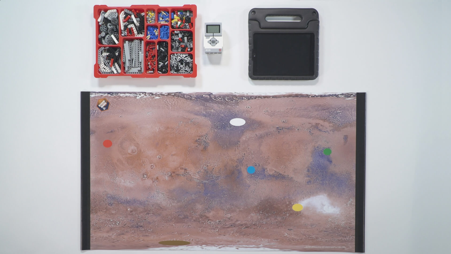 Mission: Mars Surveying the Land activity mat with bin of Lego parts within a video presentation.