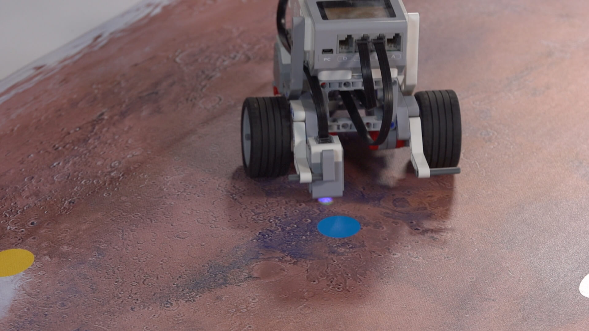 Mission: Mars Surveying the Land activity mat with built Lego rover.