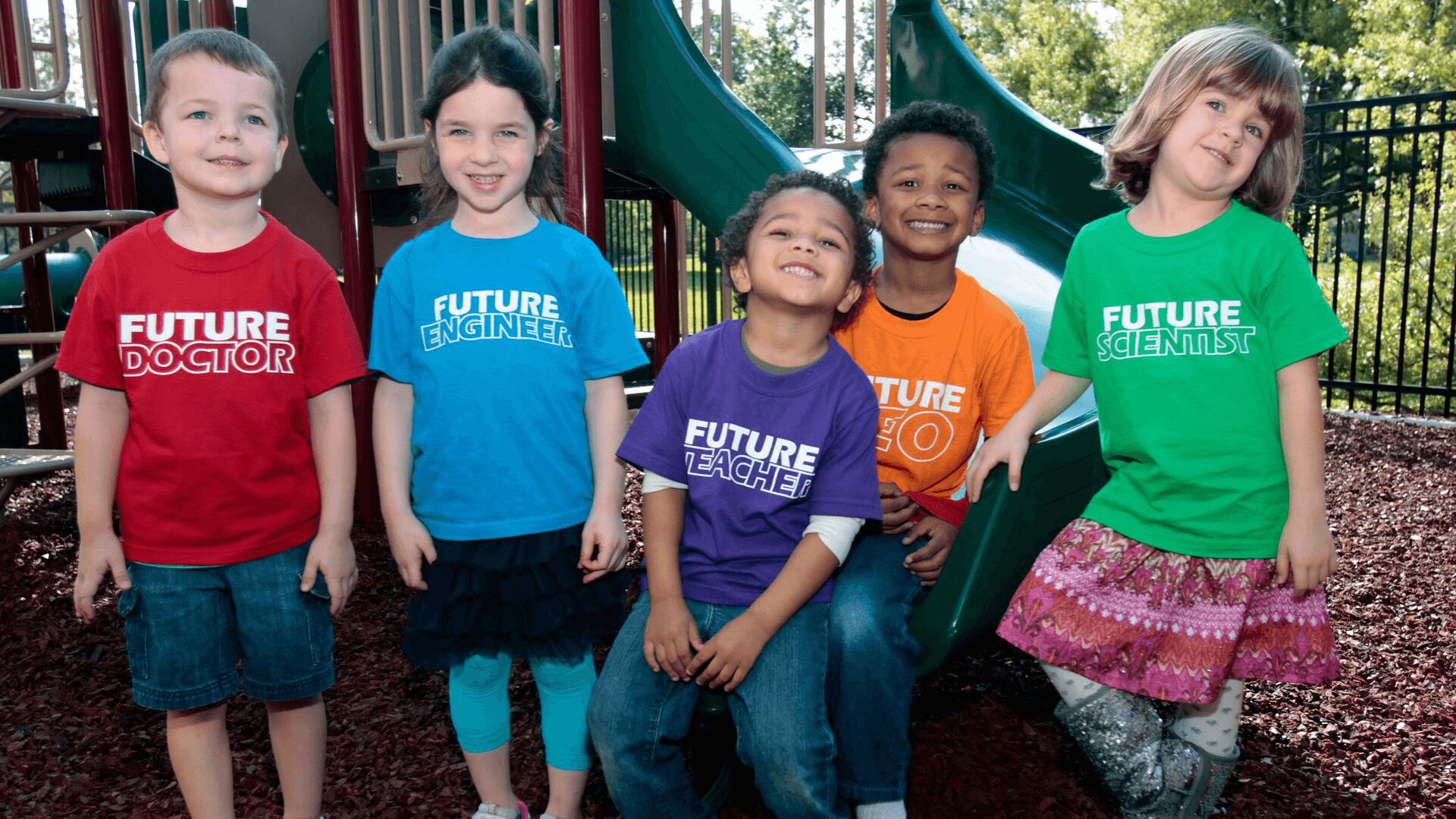Five preschool students smiling for a photo on the Science Center's Playground
