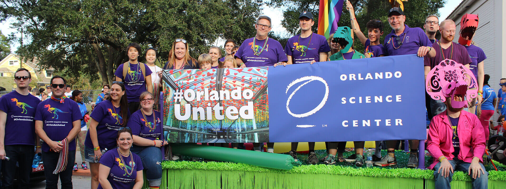 Photo of OSC staff on prade float for Come Out With Pride event.