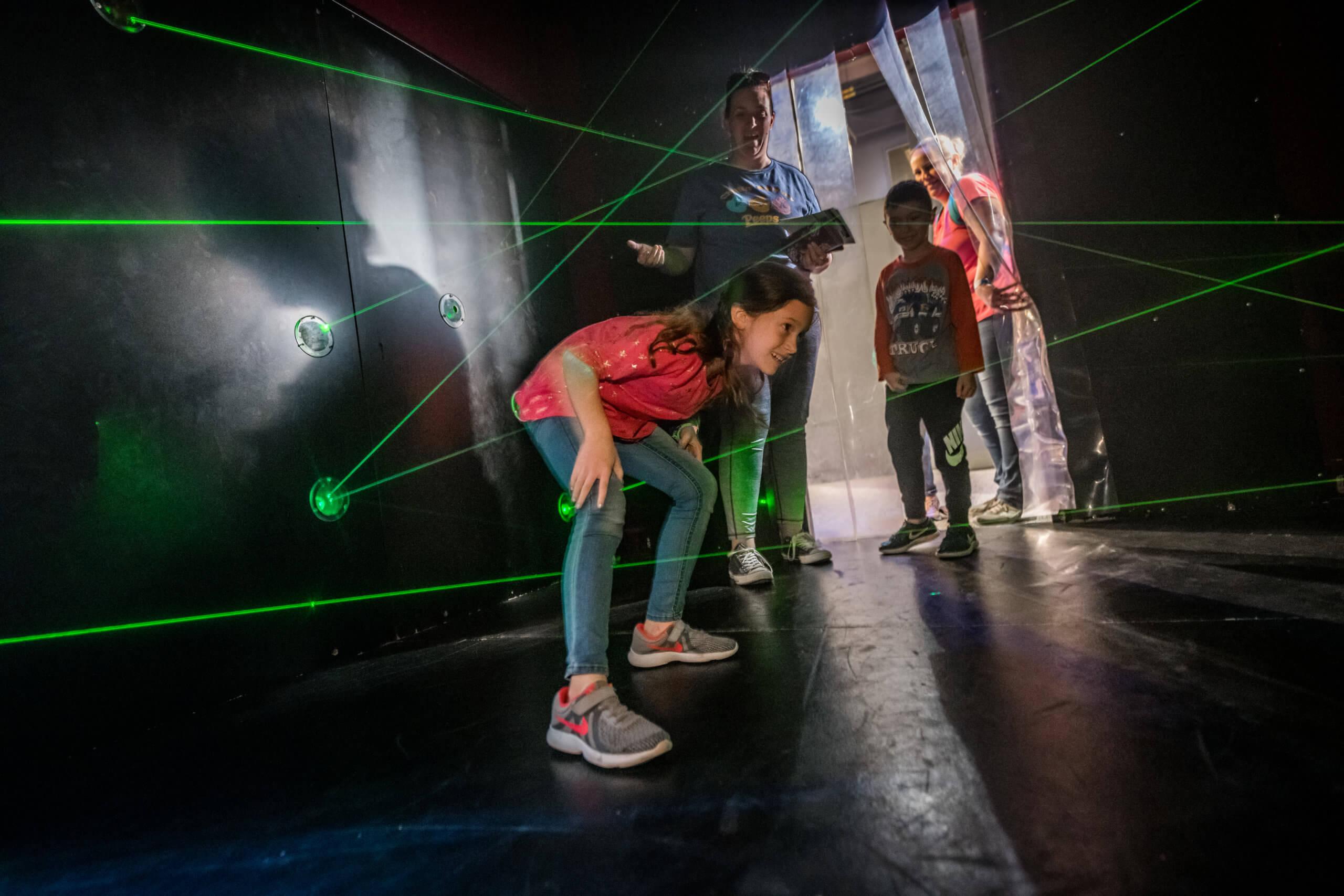 guests navigating a laser light maze