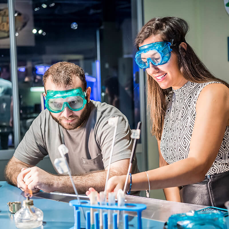 Two guests experimenting in Dr. Dare's Lab.