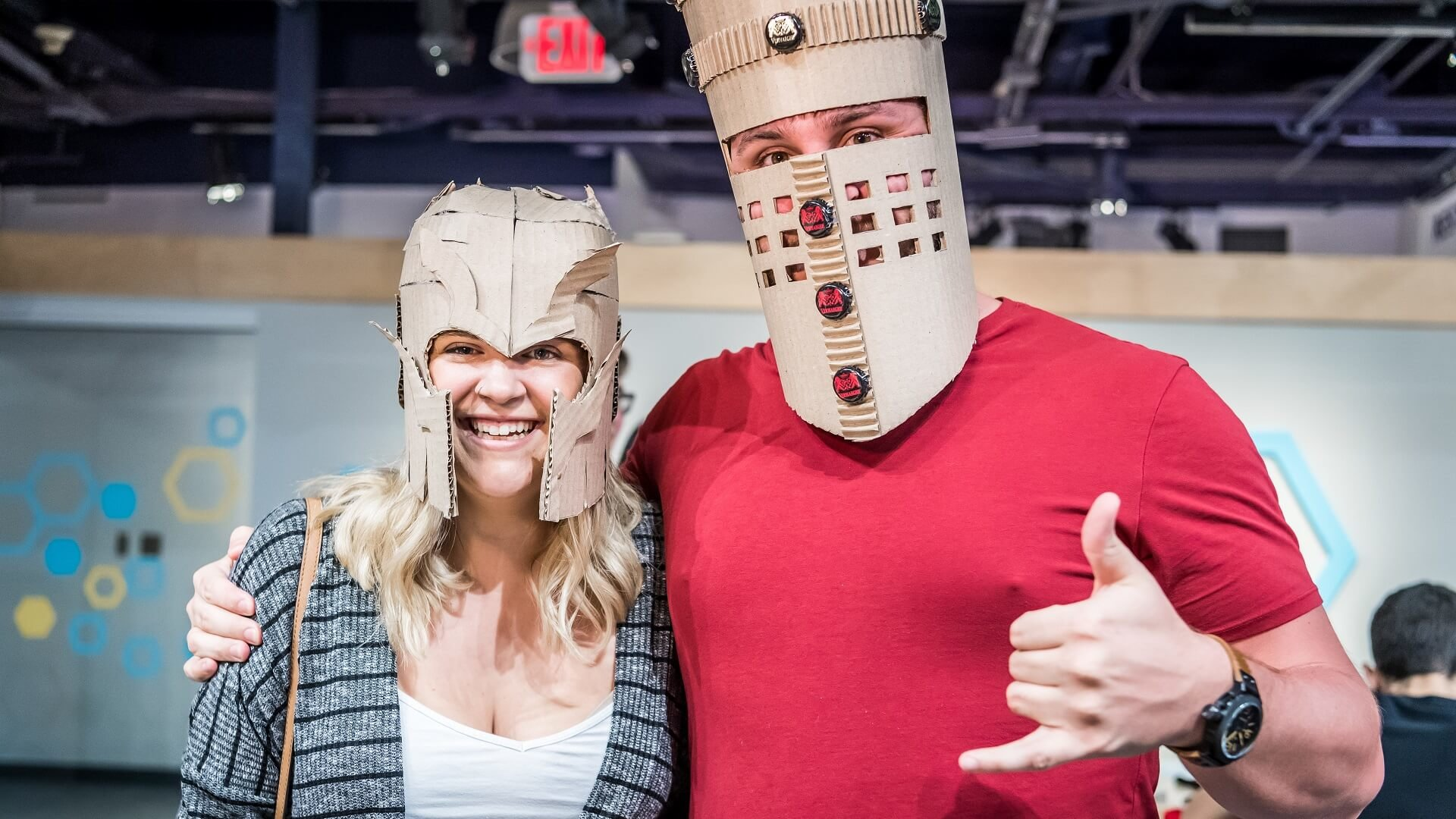 Couple wearing creative cardboard knight helmets at OSC
