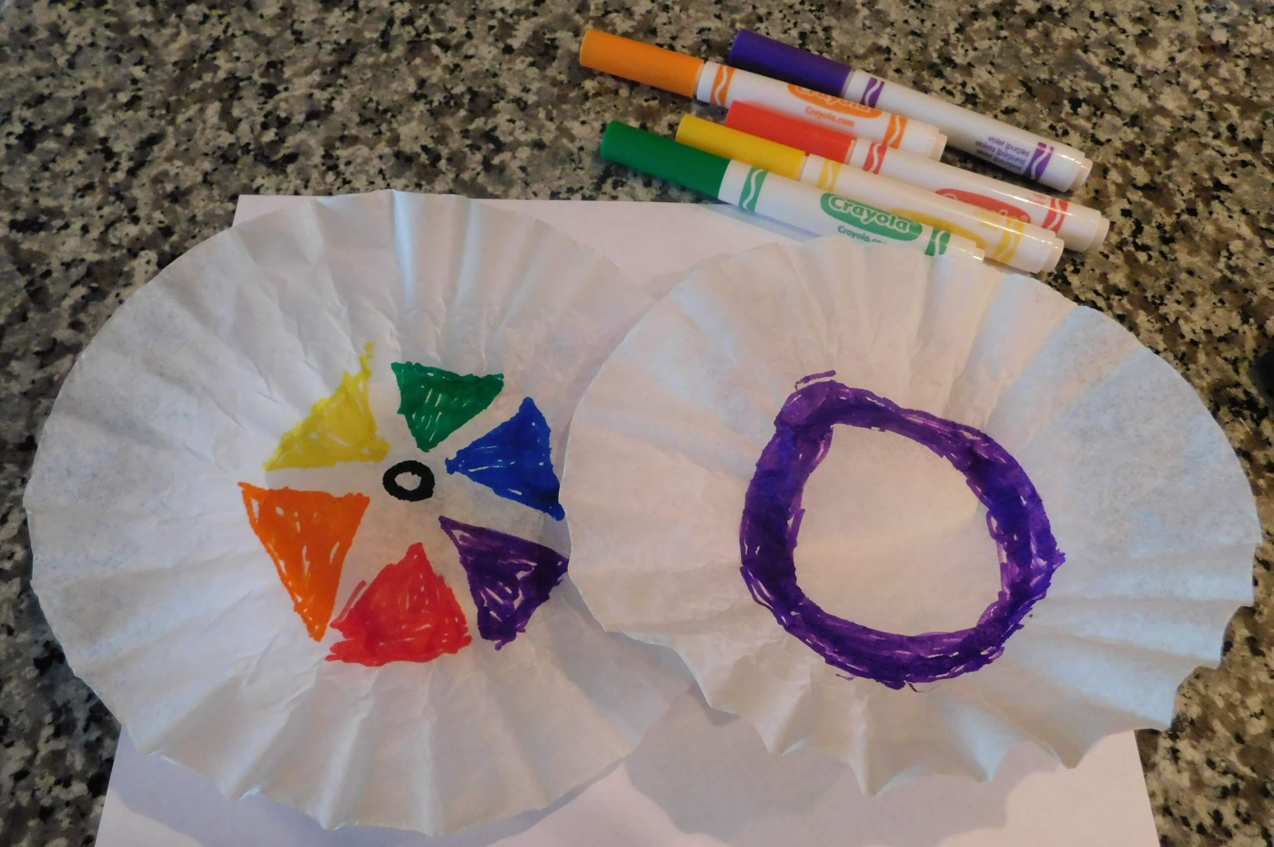 Use markers to create colorful coffee filter designs
