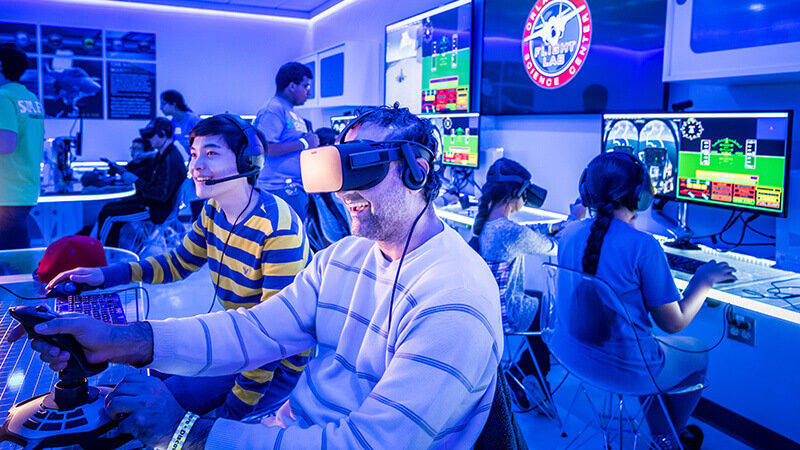 Two men using virtual reality and headsets to communicate.