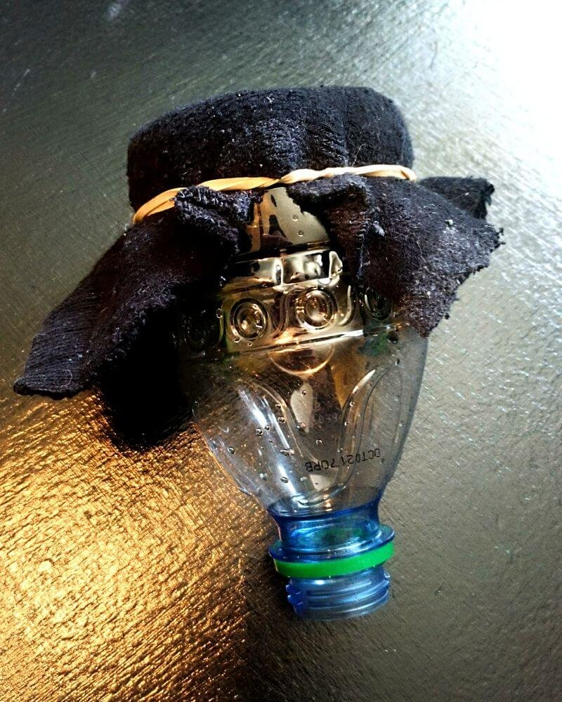 Attach sock to bottle with rubber band