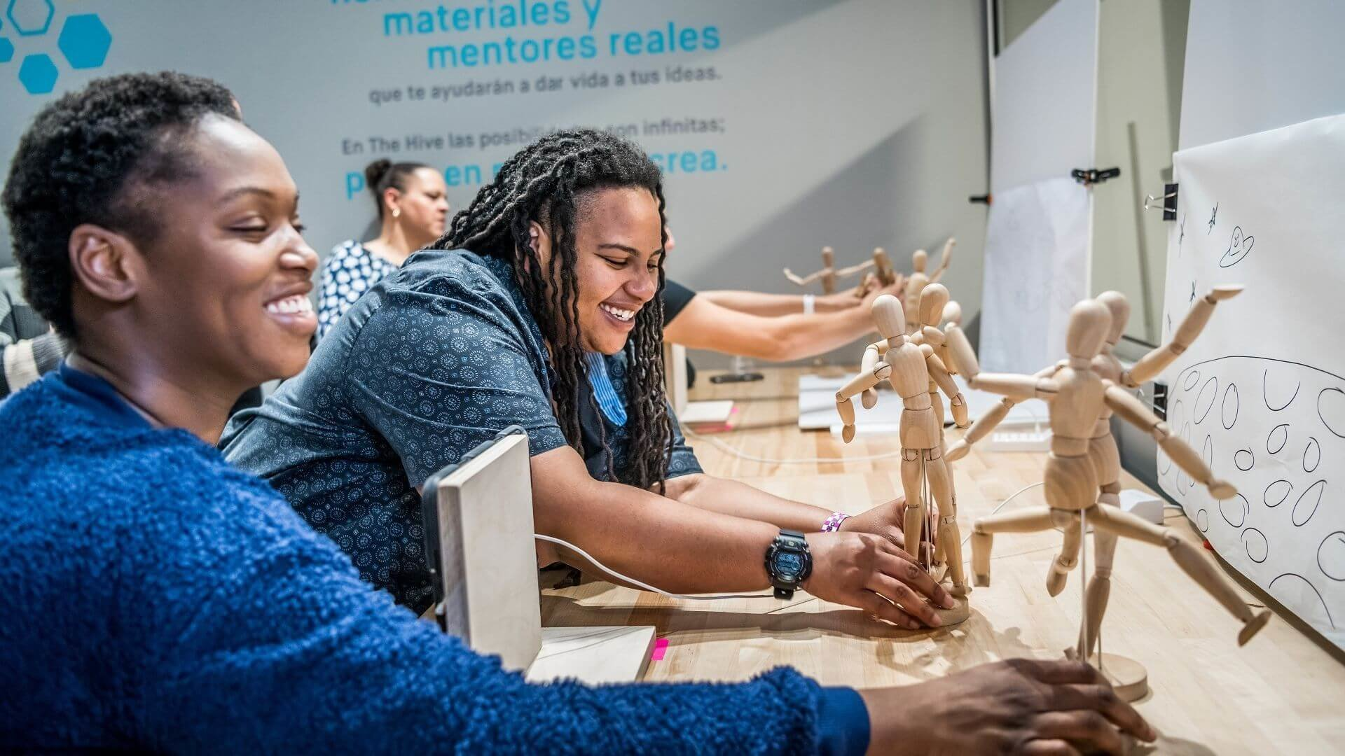Two people posing mannequin for stop motion animation movie in The Hive: A Makerspace