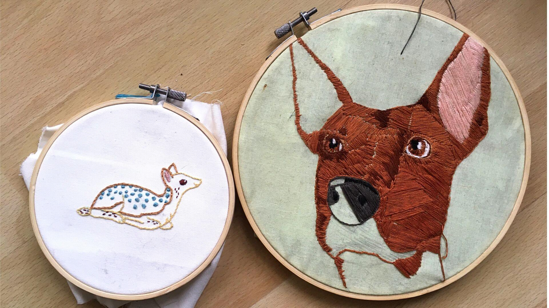 A deer and dog made using different embroidery techniques