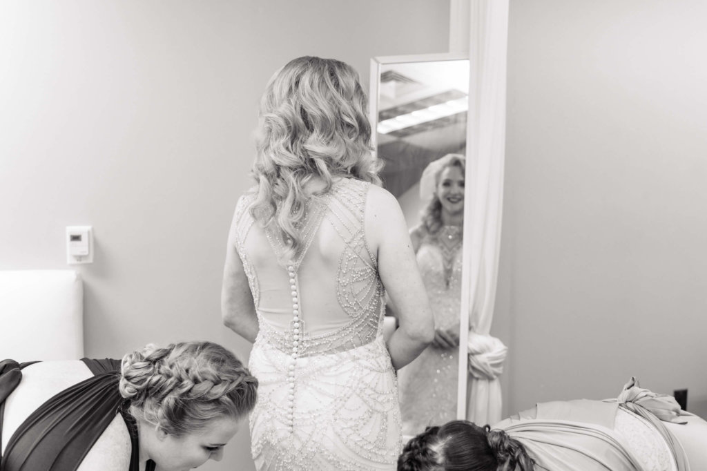 Bride getting dressed for a wedding