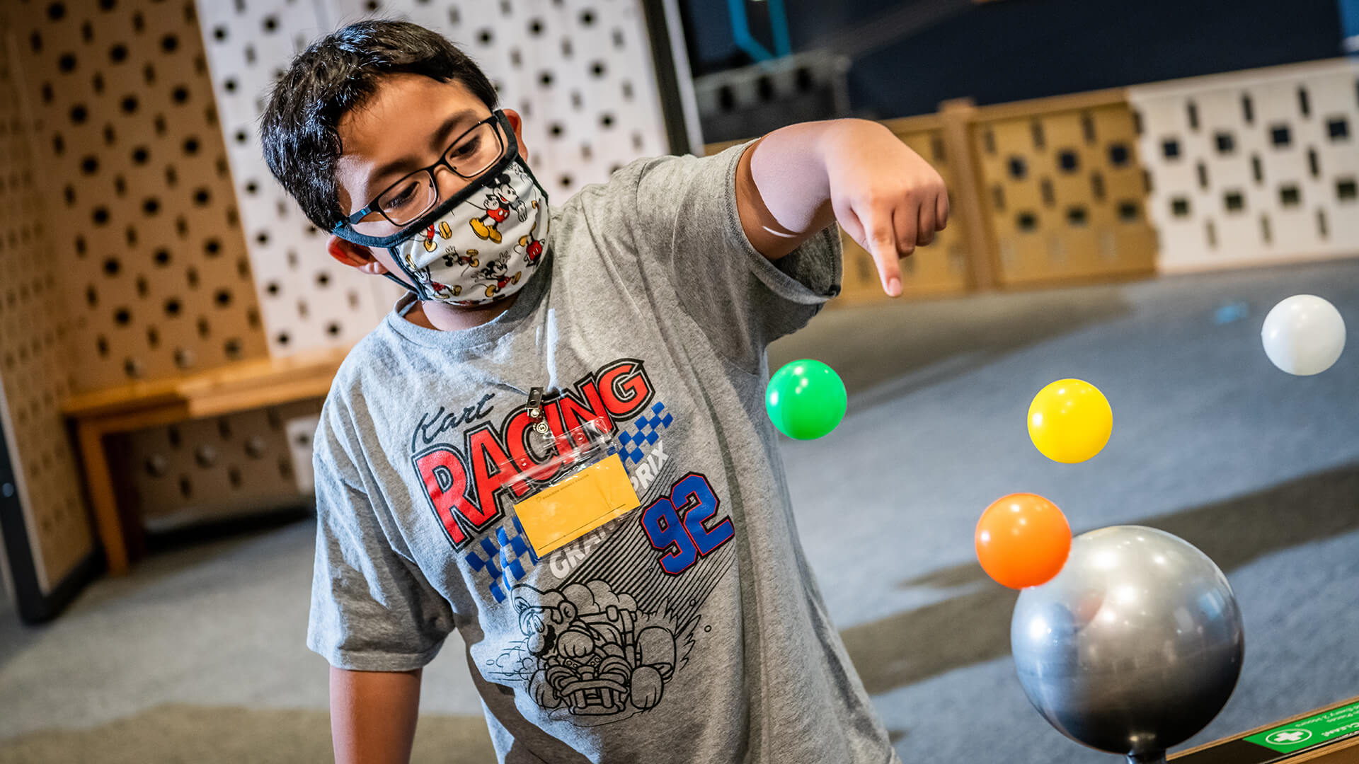 Child interacting with floating Bernoulli exhibit during Kids Night at the Museum.