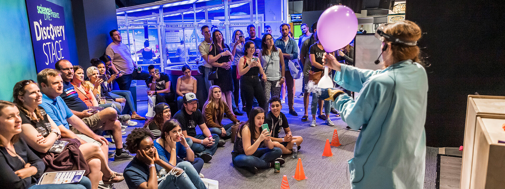 Guests watching a science demonstration
