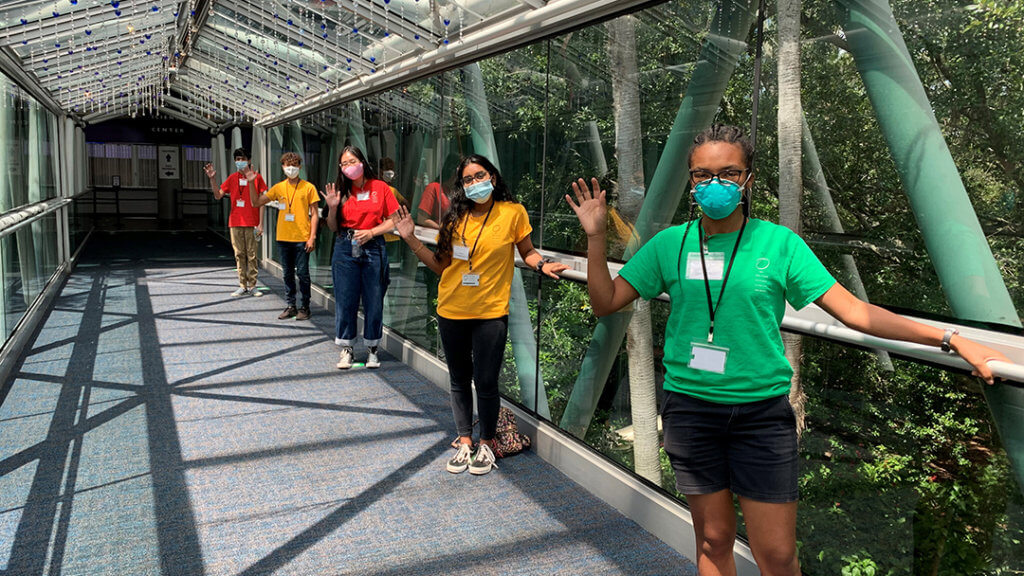 OSC Youth Volunteers welcoming on the Love Bridge entrance to the Science Center.