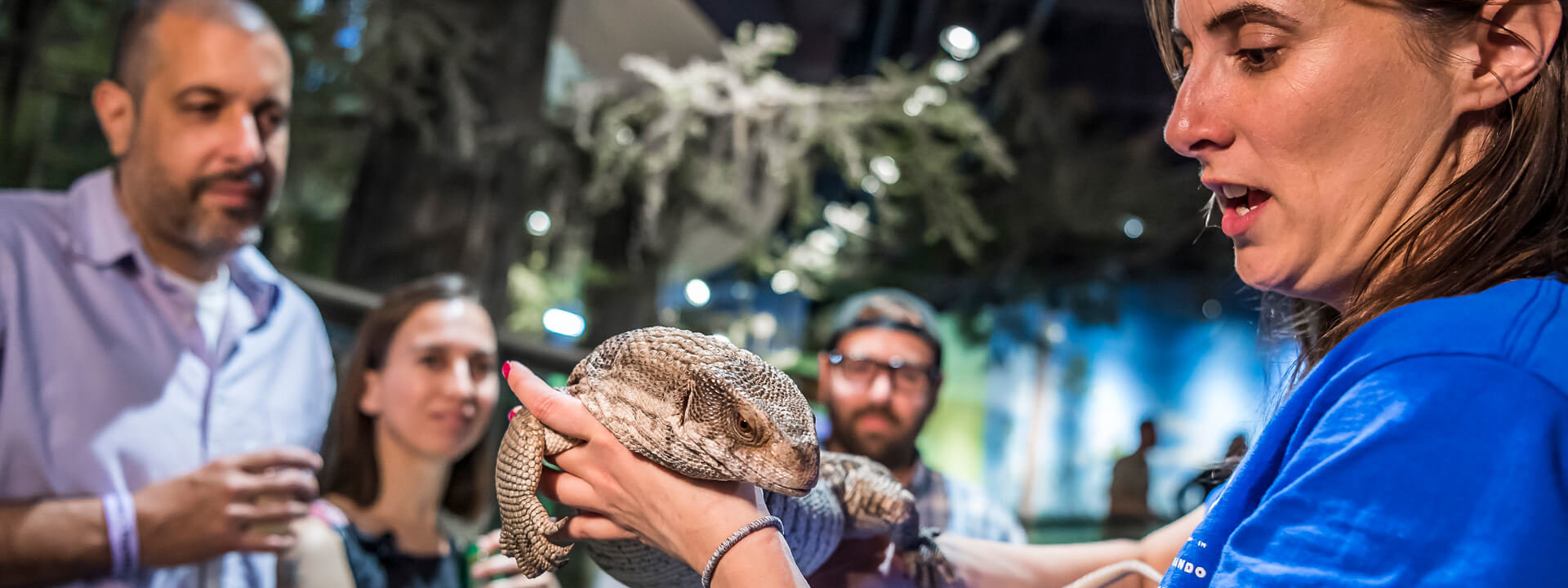 A small group of adults enjoying an animal encounter together in the NatureWorks exhibit.