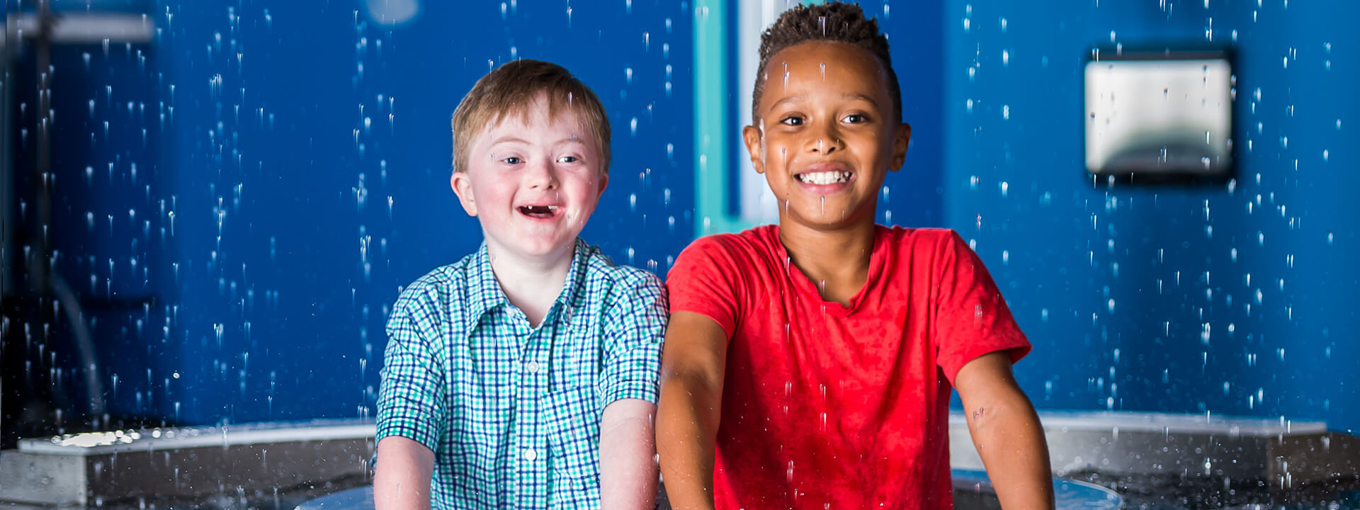 Two-children-playfully-interacting-in-KidsTown-exhibit