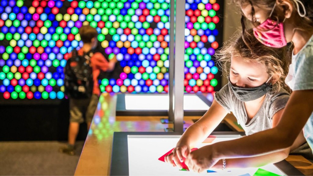 two kids playing with lights