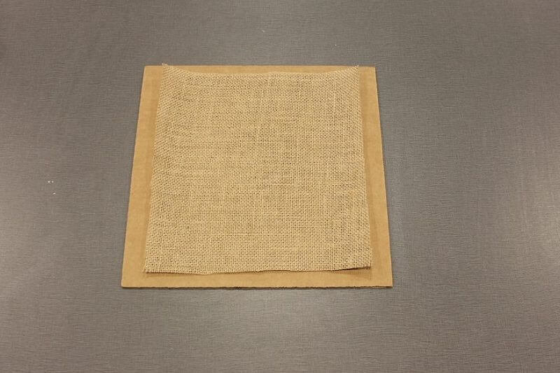 square of burlap on cardboard
