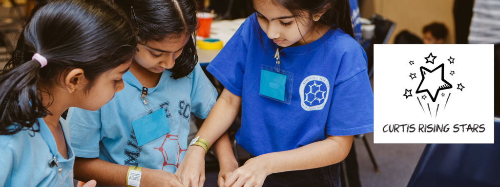 Girls design a structure with pipe cleaners during the Curtis Rising Stars Science Challenge.