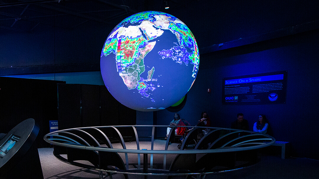 Earth climate data being shown on the floating Science On A Sphere exhibit during a live show.