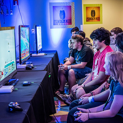 Young Adults in a video game competition at Otronicon
