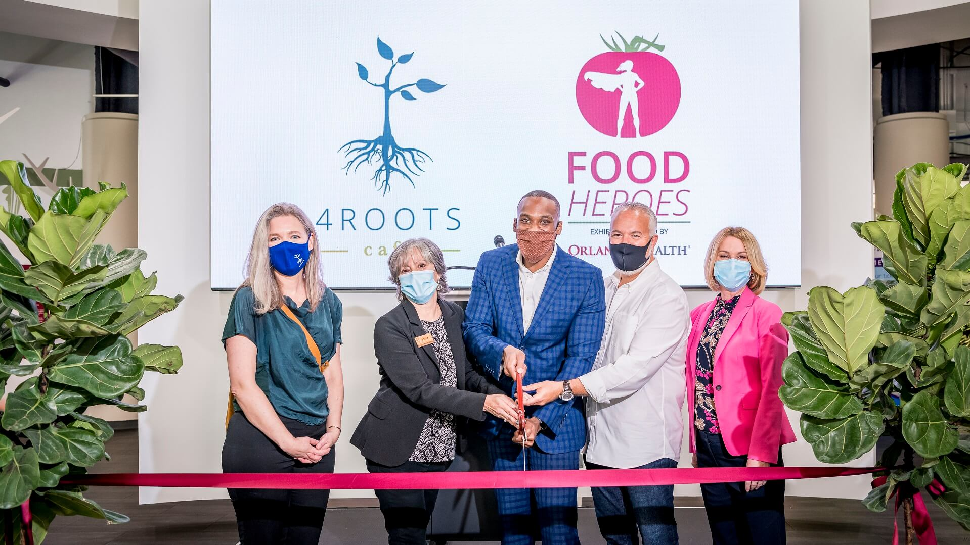 Orlando Science Center, Orlando Health, and 4Roots Farms Campus representatives cutting the ribbon for the new Food Heroes exhibit at Orlando Science Center
