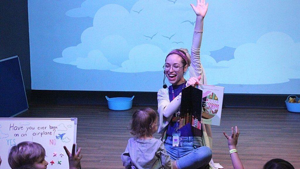 KidsTown presenter raising hand during StoryTime