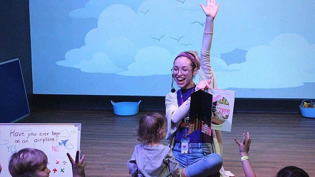 KidsTown presenter raising hand during StoryTime