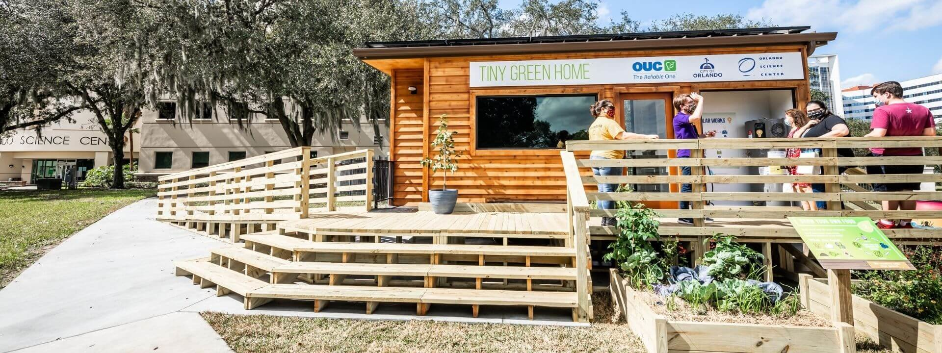 Guests touring a Tiny Green Home at Orlando Science Center