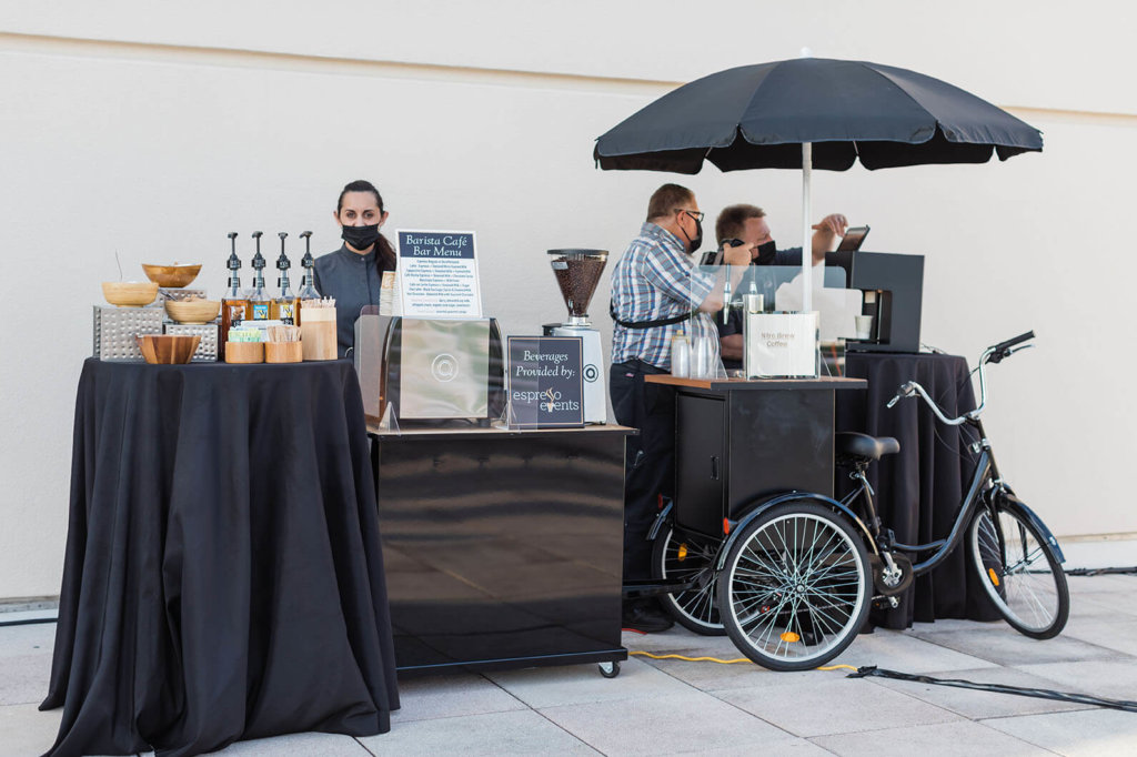 an espresso cart and table of sweets