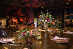 a table full of flower arrangements