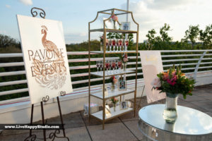 A display of signs and flowers for Pavone wedding services