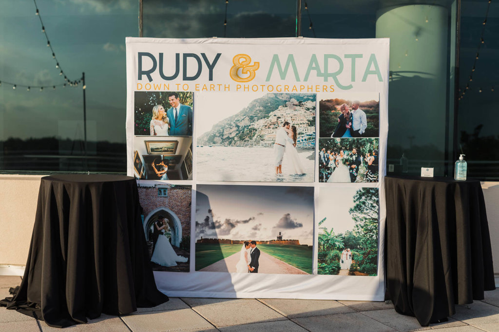 A sign for Rudy & Marta Photography at Central Florida wedding showcase