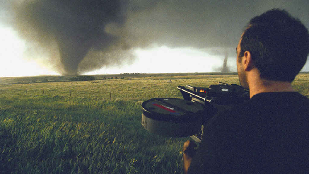 Forces of Nature - photo of tornado hunter filming two tornadoes