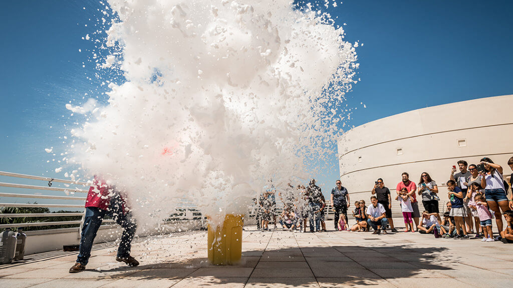 Guests watch large cloud of foam exploding during outdoor Science Live show.