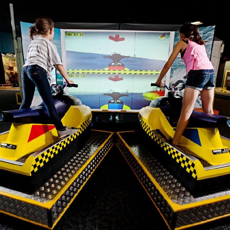 two kids on jet ski simulators