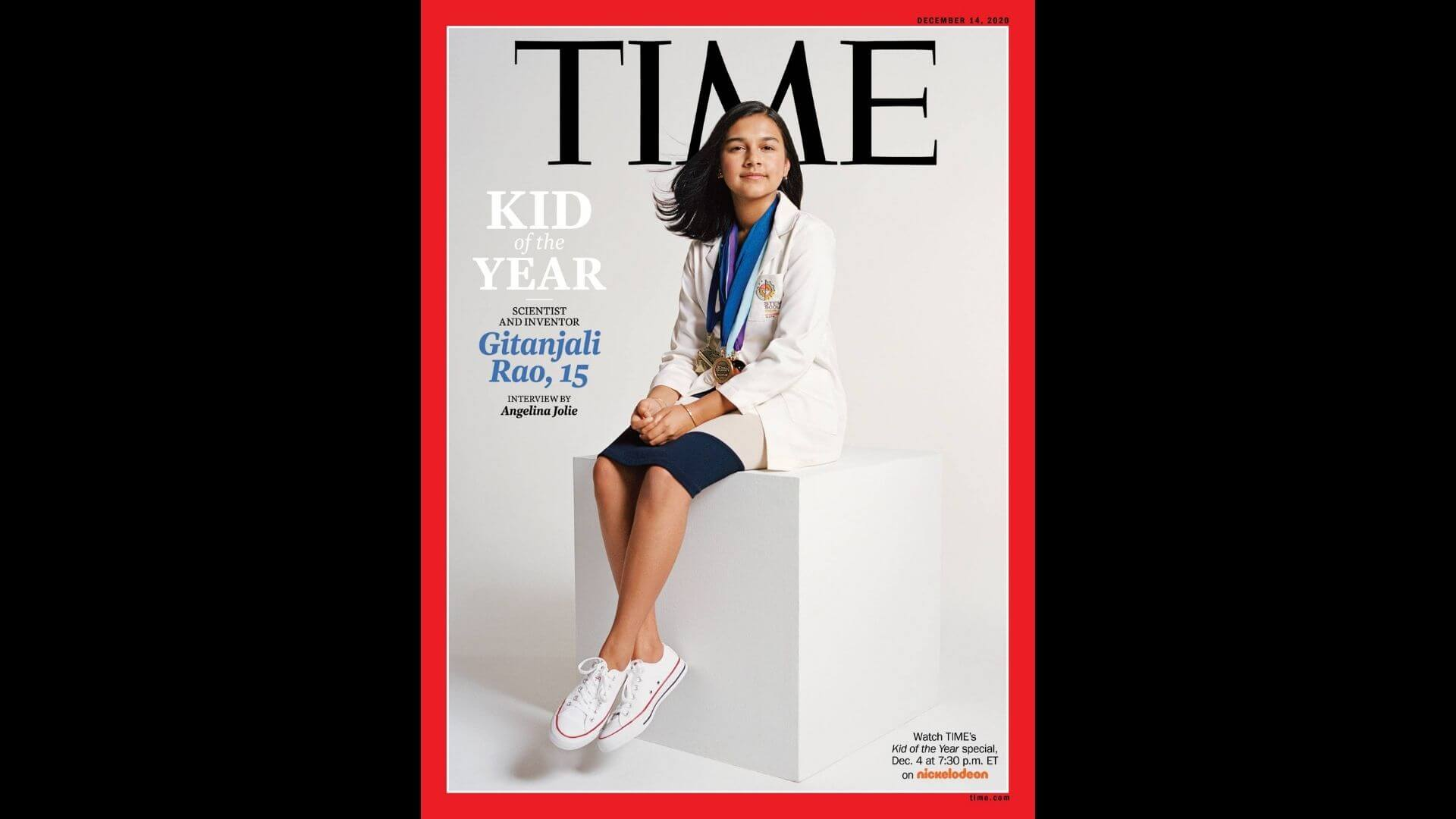 Time Kid of the Year Gitanjali Rao posing in a lab coat with medals
